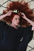 Red-haired woman with golden crown in hair