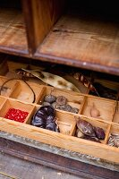 Collection of seeds in wooden organiser tray