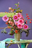 Autumnal bouquet with cornel cherries, hawthorn, rose hips, snowberry, elder, dahlias & cosmos