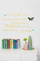 Wall decorated with motto & butterfly cut-out