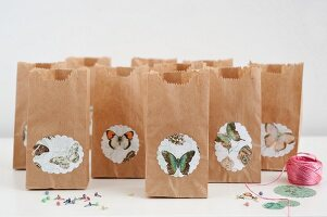Butterfly motifs stuck on brown paper gift bags