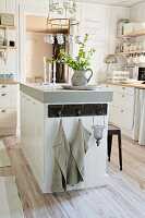 Free-standing counter in white, country-house kitchen
