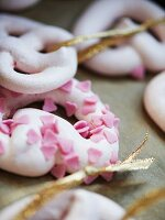 Meringue rings scattered with sugar hearts as Christmas tree decorations