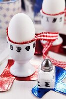 Eggcups and salt cellar decorated with alphabet washi tape