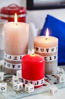 Pillar candles decorated with alphabet washi tape and alphabet dice