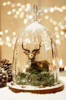 Deer ornament under glass cover
