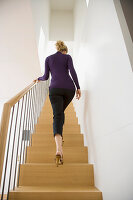 A woman walking upstairs