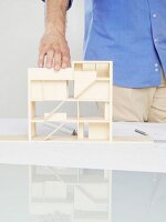 A man looking at an architectural model