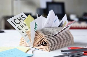 Note rack made from old book with pages folding in to centre
