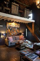 Double-height interior and lounge area below gallery and black walls
