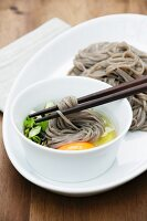 Cold soba noodles with raw egg and spring onions