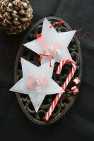 Star-shaped, transparent paper bags filled with sweets