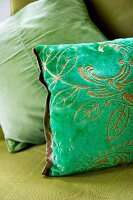 Green scatter cushion with devoré pattern