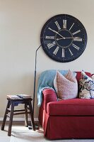 Cropped couch with large wall clock in living room