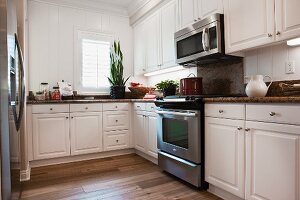 View of kitchen with white cabinets; Burlington; Vermont; USA