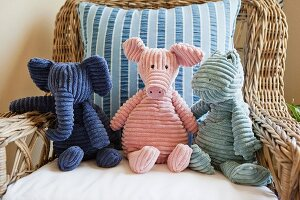 Soft toys on wicker armchair; California; USA