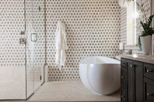 Contemporary bathroom with bathtub and glass shower; Irvine; California; USA