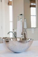 Close-up of stainless steel sink in bathroom; Irvine; California; USA