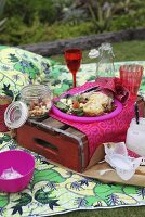 Picnic on picnic blanket in garden