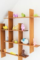 Cardboard animal ornaments on quirky shelving system