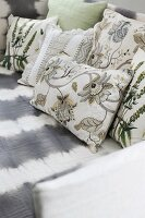 Scatter cushions with various floral, country-house-style covers