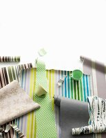 Rolls of wallpaper in different striped and floral patterns