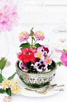 Arrangement of Lantana, violas, Lewisia & strawberry flowers