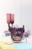 Tealight holder wrapped in lavender sprigs and cord decorating table