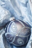 Silver Christmas tree bauble nestled in paper