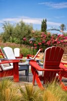 Red wooden chairs on the terrace at the Beldi Country Club, hotel complex on the outskirts of Marrakesh, Morocco