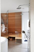 View from bathroom into sauna with glass partition