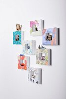 Hand-crafted picture frames used as display cases on wall