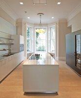 Private Apartment, London, United Kingdom. Architect: Hill Mitchell Berry, 2014. White, monolithic kitchen counter in designer kitchen