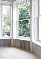 Traditional room with bay window overlooking garden