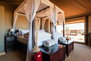 An elegant bedroom in 'Dune Camp' in Wolwedans, NamibRand Nature Reserve, Namibia, Africa