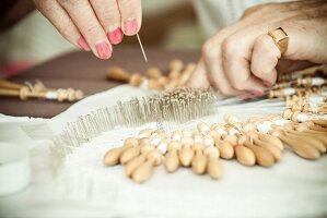 Woman making bobbin lace
