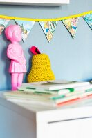 Hand-sewn, colourful bunting in child's bedroom