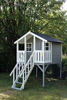 Wooden playhouse in garden