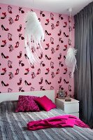 Bedroom in shades of grey and pink with whimsical elements: pendant lamps with white lampshades shaped like wings and shoe-patterned wallpaper