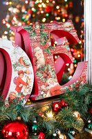 Christmas decorations, fir branches and decorative letters