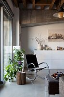Loft apartment with white sideboard, rocking chair and house plants