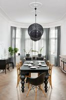 Eclectic, elegant dining room with black and white colour scheme, traditional ambiance and bay window