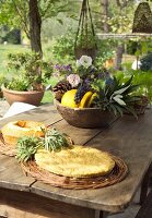 Bowl of fruit and wicker mat on rustic wooden table on terrace
