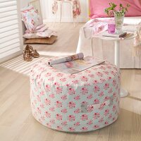 Pouffe with hand-sewn, floral cover in romantic, feminine bedroom
