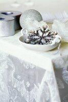 Glittering Christmas decorations on silk organza tablecloth by Carolyn Quartermaine