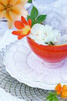 Place setting decorated with flowers & doilies
