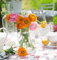 Posy in retro glass vase on outdoor table