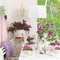 Spring atmosphere - table set for afternoon coffee decorated with lilac