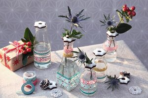 Bottles decorated with fondant stars and washi tape used as small, festive vases