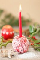 Sugared apple used as festive candlestick